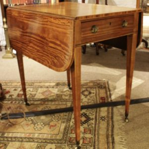 A Regency Satin Wood Drop Leaf Table with Drawer