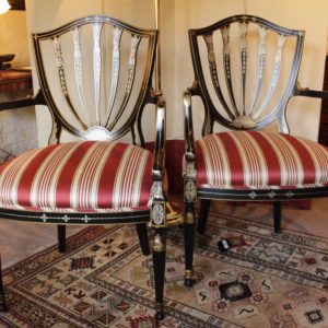 A Pair of Hepplewhite Open Armchairs 20th C.